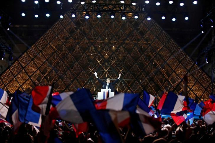French President-elect Emmanuel Macron celebrates on the stage at his victory rally near the Louvre in Paris, France May 7, 2017. REUTERS/Christian Hartmann/Files