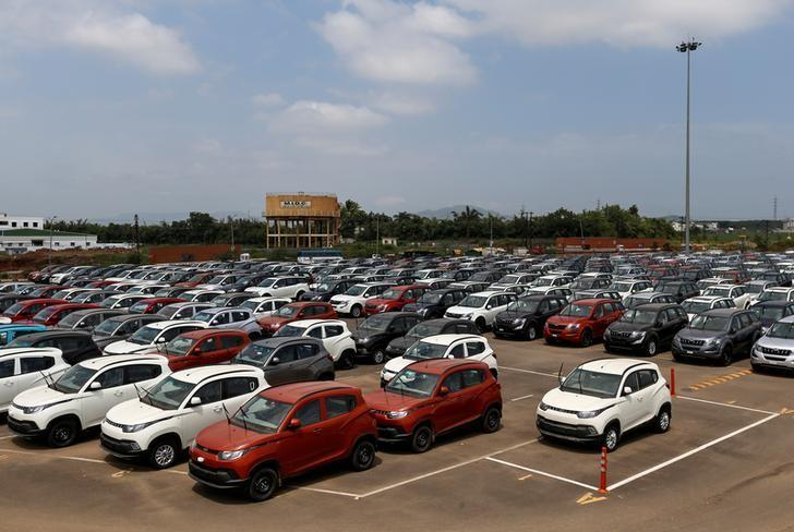 Vehicles are parked at the Mahindra & Mahindra manufacturing plant in Chakan, India, September 30, 2016. REUTERS/Danish Siddiqui/Files