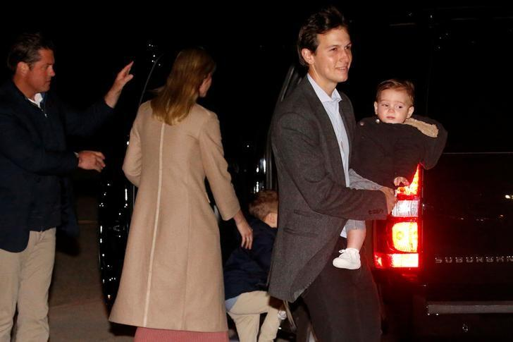 White House senior advisor Jared Kushner holds his son Theo as his family returns to Washington with his father-in-law, U.S. President Donald Trump, after a weekend at Trump's New Jersey golf estate home, via Air Force One to Joint Base Andrews, Maryland, U.S. May 7, 2017. REUTERS/Jonathan Ernst