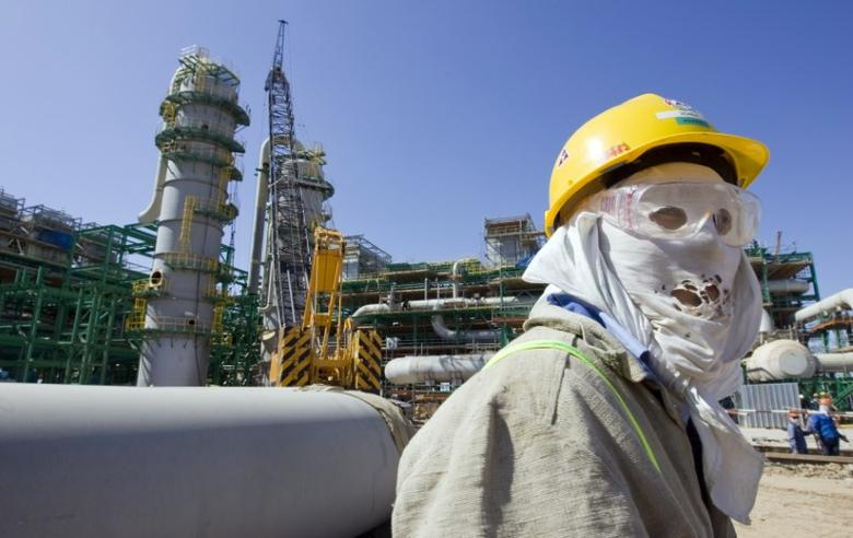 A worker stands at the Bolashak processing plant on a coast near Kashagan offshore oil field in the Caspian sea, western Kazakhstan August 11, 2009.  REUTERS/Shamil Zhumatov