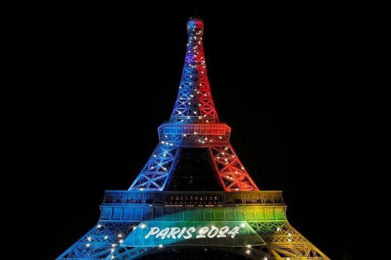 The Eiffel Tower is lit in the colours of the Olympic flag during the launch of the international campaign for the Paris bid to host the 2024 Olympic Games, in Paris, France, February 3, 2017. REUTERS/Benoit Tessier