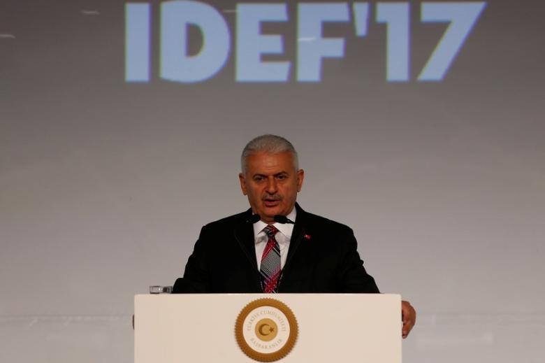 Turkish Prime Minister Binali Yildirim speaks during the opening ceremony of IDEF'17, the 13th International Defence Industry Fair, in Istanbul, Turkey, May 9, 2017. REUTERS/Murad Sezer