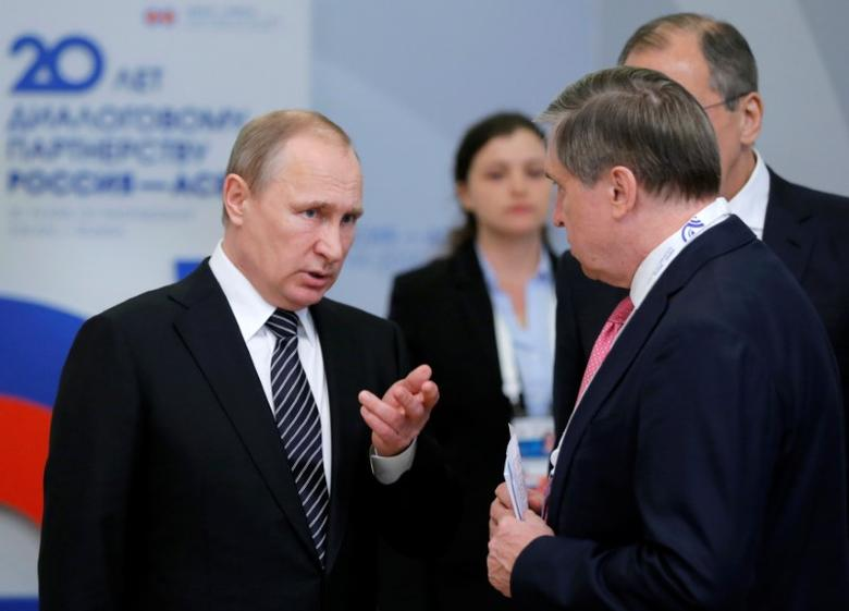 FILE PHOTO: Russia's President Vladimir Putin (L) talks to Russian Presidential Aide Yuri Ushakov on the sidelines of the Russia-ASEAN summit in Sochi, Russia, May 19, 2016. REUTERS/Yuri Kochetkov/Pool