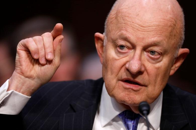 FILE PHOTO: Former Director of National Intelligence James Clapper testifies about potential Russian interference in the presidential election before the Senate Judiciary Committee on Capitol Hill, Washington, D.C., U.S. May 8, 2017.  REUTERS/Aaron P. Bernstein