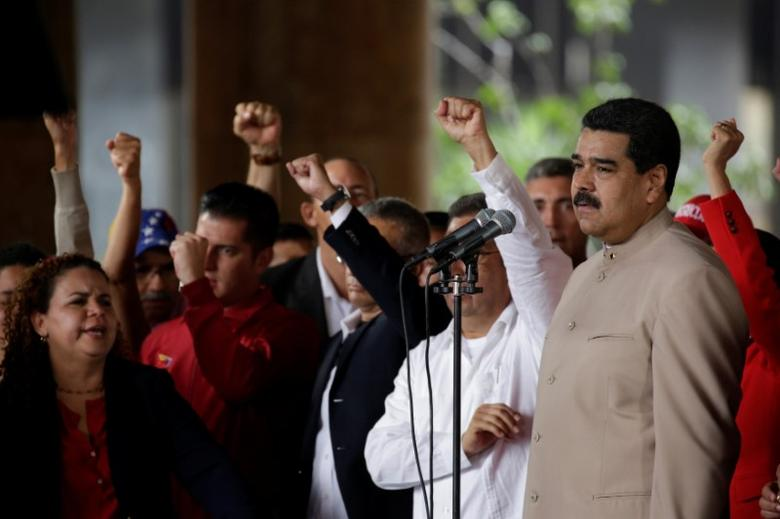 Venezuela's President Nicolas Maduro pauses while speaking during a gathering outside the National Electoral Council (CNE) where he presented his proposal to set up a National Constituent Assembly, in Caracas, Venezuela May 3, 2017. REUTERS/Marco Bello