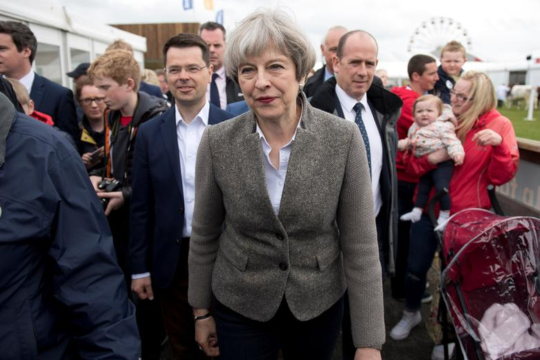 Britain's Prime Minister Theresa May meets visitors at the Balmoral Show near Lisburn during a campaign trip in Northern Ireland, May 13, 2017. REUTERS/Justin Tallis/Pool