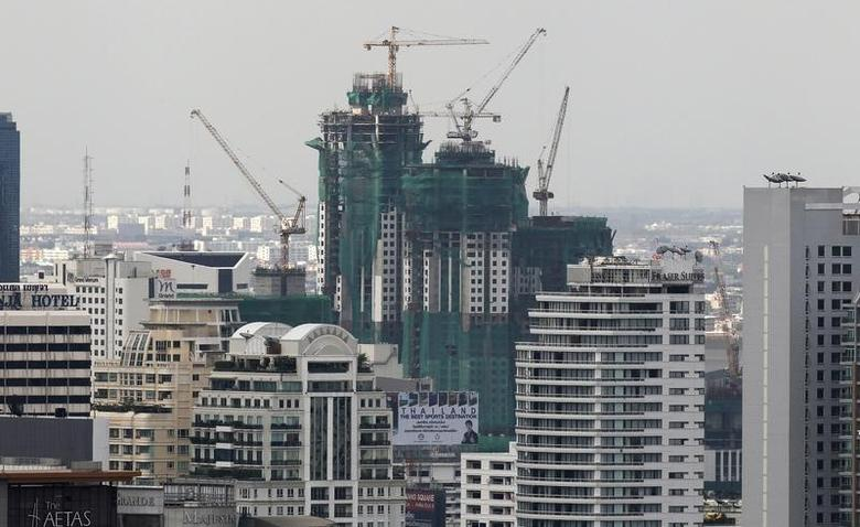 An office building under construction is seen in Bangkok?s business district July 28, 2011.  REUTERS/Sukree Sukplang