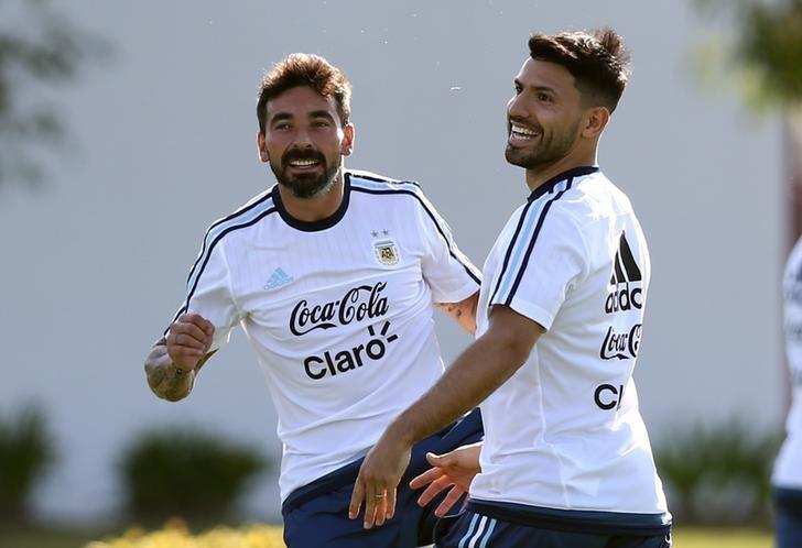 Football Soccer - Argentina's national soccer team training session - World Cup 2018 Qualifiers - Buenos Aires, Argentina - 21/3/17 - Argentina's Sergio Aguero (R) and Ezequiel Lavezzi attend a training session ahead of their match against Chile. REUTERS/Marcos Brindicci/Files