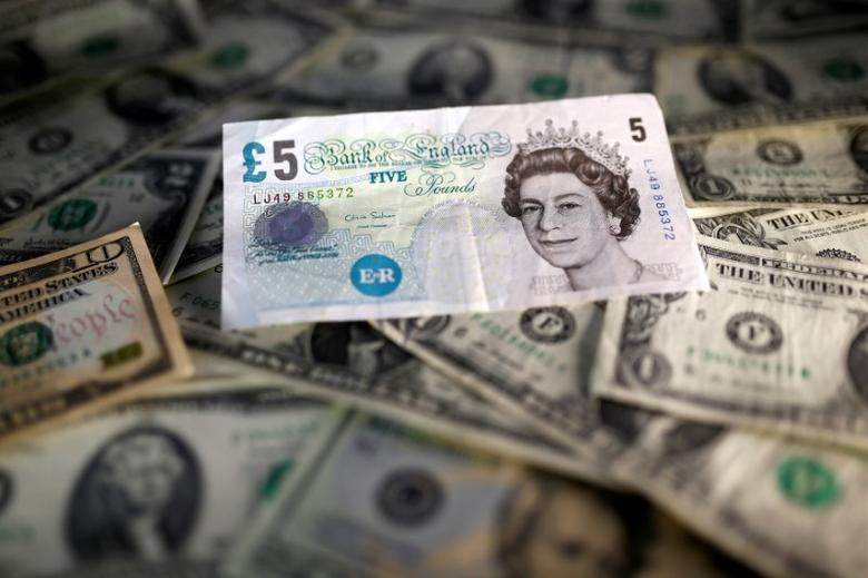 U.S. dollar and British pound notes are seen in this November 7, 2016 picture illustration. REUTERS/Dado Ruvic/Illustration