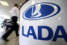 The Lada logo is pictured in a car salesroom for Lada cars, produced by the Russian AvtoVAZ car maker, at a dealership in St. Petersburg, July 9, 2014. Russian car sales plunged 17.3 percent year-on-year in June, according to a lobby group for Europe's top carmakers, accelerating their recent slide and leading the group to slash its forecast for sales in the country this year by 12 percent. REUTERS/Alexander Demianchuk (RUSSIA - Tags: TRANSPORT BUSINESS LOGO)