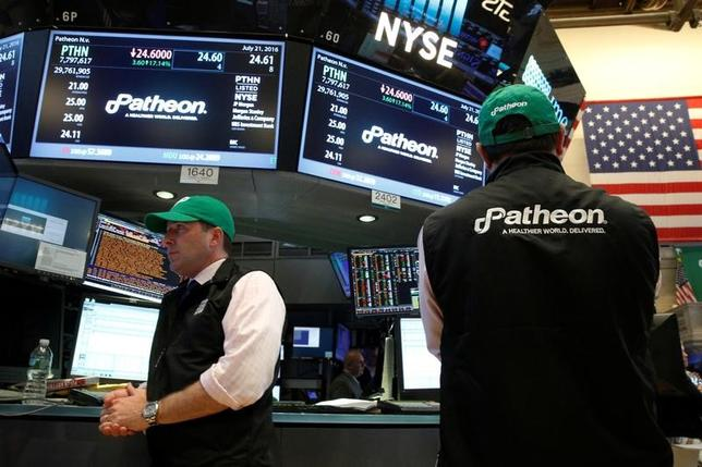 Traders work at the post where shares of Patheon NV is traded on the floor of the New York Stock Exchange (NYSE) in New York City, U.S., July 21, 2016.  REUTERS/Brendan McDermid/Files