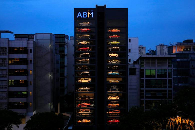 An exotic used car dealership designed to resemble a vending machine in Singapore May 15, 2017. The dealership houses up to 60 exotic cars in a 15 storey building which uses a fish-bone type lift system to deliver cars to clients within minutes.   REUTERS/Thomas White