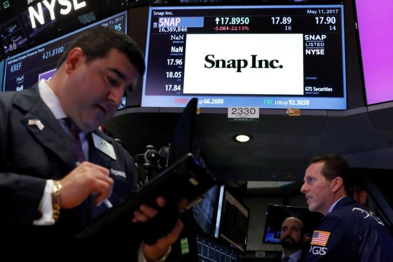 Specialist traders work at the post where Snap Inc. is traded on the floor of the New York Stock Exchange (NYSE) in New York, U.S., May 11, 2017. REUTERS/Brendan McDermid