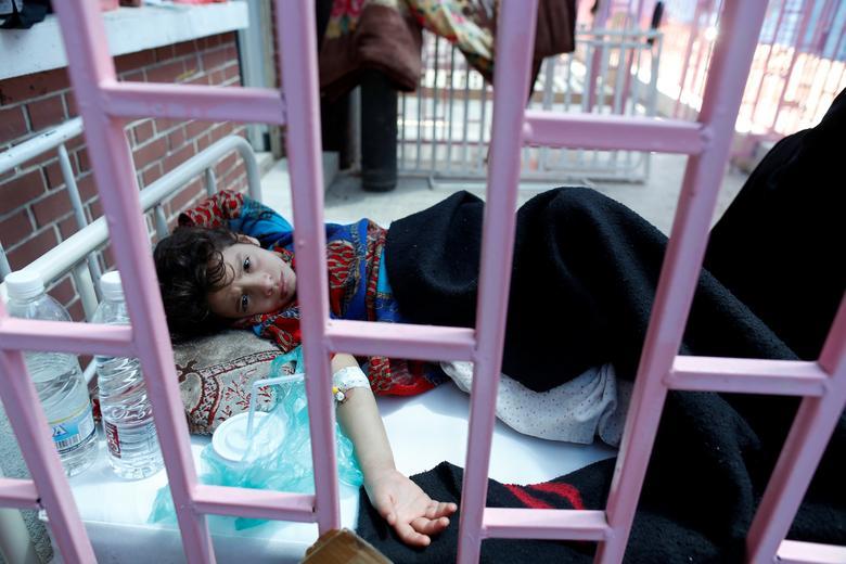 A cholera-infected girl lies on a bed at a hospital in Sanaa. REUTERS/Khaled Abdullah