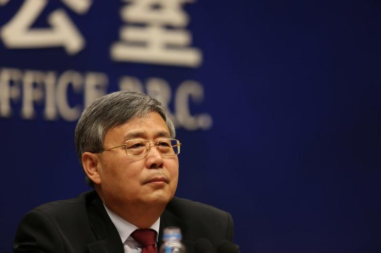 Guo Shuqing, China banking regulator, attends a news conference ahead of China's parliament in Beijing, March 2, 2017. REUTERS/Shu Zhang