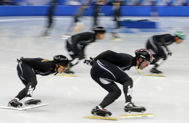 FILE PHOTO: U.S. short track speed skaters Jessica Smith (L) and Chris Creveling (2nd R) practise with U.S. team members in preparation for the 2014 Sochi Winter Olympics, February 3, 2014. REUTERS/Alexander Demianchuk