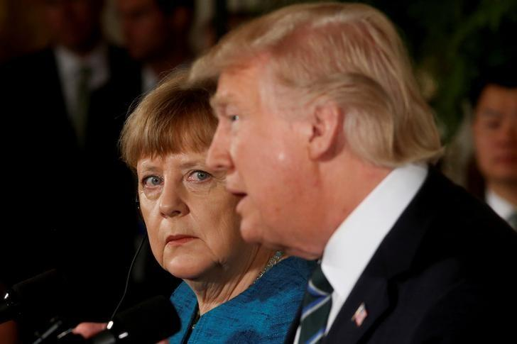FILE PHOTO: Germany's Chancellor Angela Merkel and U.S. President Donald Trump hold a joint news conference in the East Room of the White House in Washington, U.S., March 17, 2017. REUTERS/Jonathan Ernst/File Photo