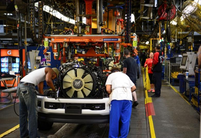 FILE PHOTO: Workers assemble a Ford truck at the new Louisville Ford truck plant in Louisville, Kentucky, U.S. September 30, 2016.  REUTERS/Bryan Woolston/File Photo