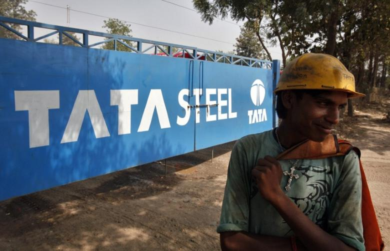 A labourer stands outside a Tata Steel stockyard in the northern Indian city of Chandigarh May 23, 2013.   REUTERS/Ajay Verma