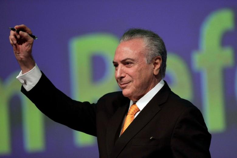 Brazil's President Michel Temer gestures during opening ceremony of the 20th conference of the march in defense of the municipalities, in Brasilia, Brazil May 16, 2017. REUTERS/Ueslei Marcelino