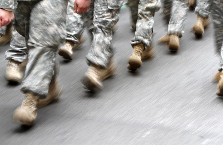 U.S. army soldiers are seen marching in the St. Patrick's Day Parade in New York, March 16, 2013.  REUTERS/Carlo Allegri/Files