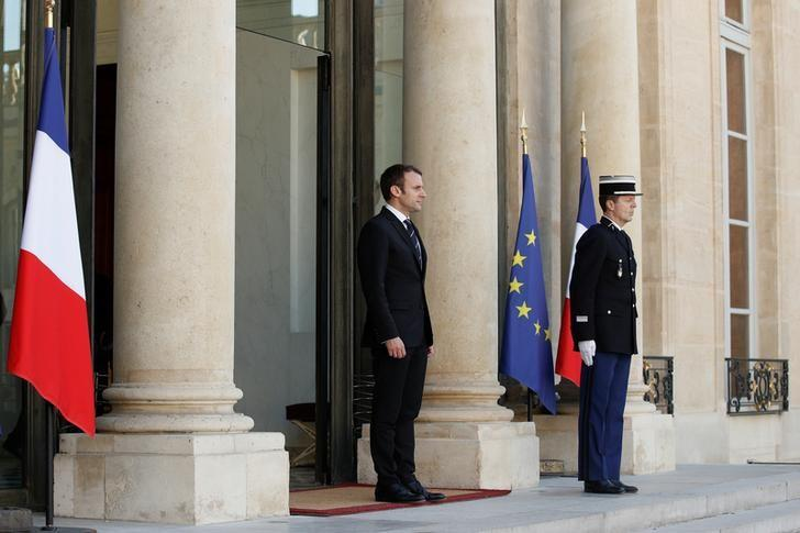 French President Emmanuel Macron waits for a guest on the steps at the Elysee Palace in Paris, France, May 16, 2017.   REUTERS/Yoan Valat/Pool