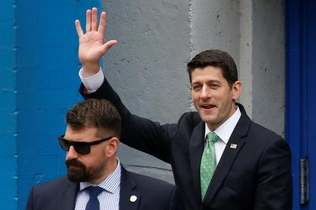 Paul Ryan, Speaker of the United States House of Representatives, waves to demonstrators as he departs Public School 162 in the Harlem area of New York, U.S. May 9, 2017.   REUTERS/Carlo Allegri