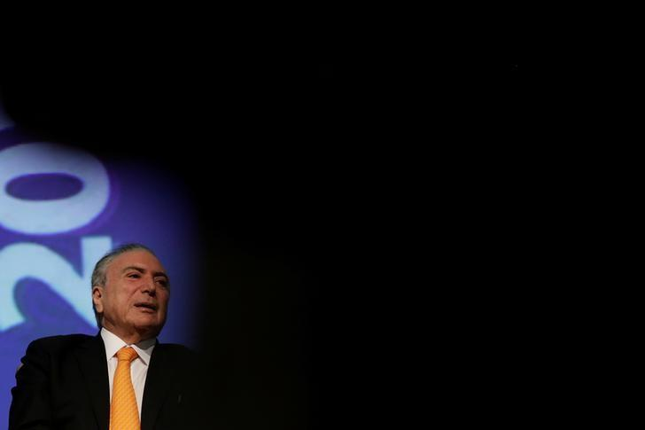 FILE PHOTO: Brazil's President Michel Temer gestures during opening ceremony of the 20th conference of the march in defense of the municipalities, in Brasilia, Brazil May 16, 2017. REUTERS/Ueslei Marcelino/File Photo