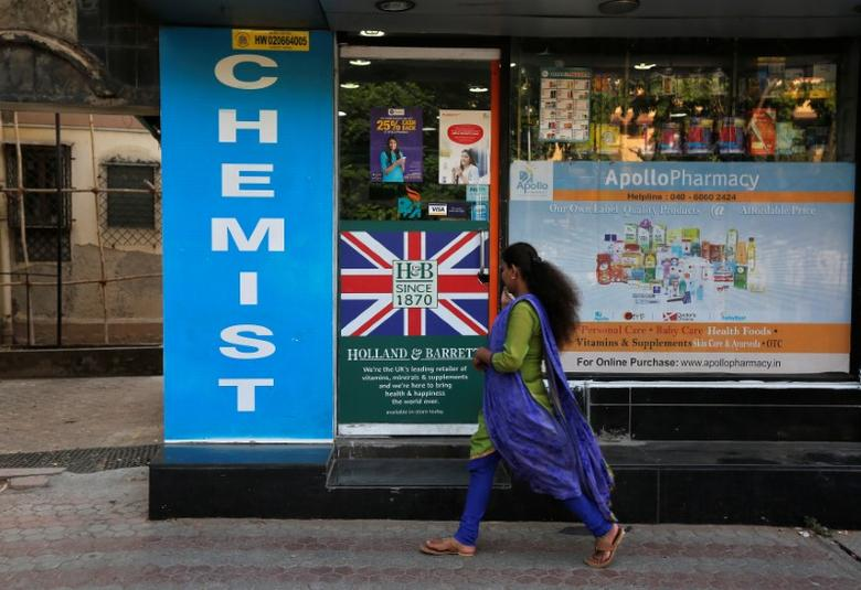 A woman walks past a chemist shop in Mumbai, India April 28, 2017. REUTERS/Shailesh Andrade