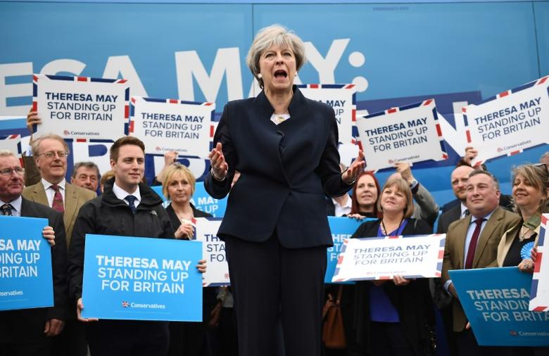 Britain's Prime Minister Theresa May addresses supporters and members of the media in front of the Conservative party's election campaign bus at an airfield north of Newcastle, May 12, 2017. REUTERS/Justin Tallis/Pool