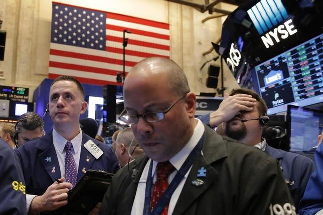 Traders work on the floor of the New York Stock Exchange (NYSE) shortly after the opening bell in New York, NY, U.S. December 14, 2016. REUTERS/Lucas Jackson/Files