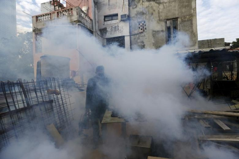 A Cuban military reservist fumigates a home balcony as part of the preventive measures against the Zika virus and other mosquito-borne diseases in Havana, Cuba March 18, 2016. REUTERS/Ivan Alvarado