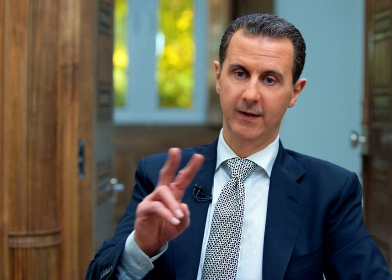 Syria's President Bashar al-Assad speaks during an interview with AFP news agency in Damascus, Syria in this handout picture provided by SANA on April 13, 2017. SANA/Handout via REUTERS