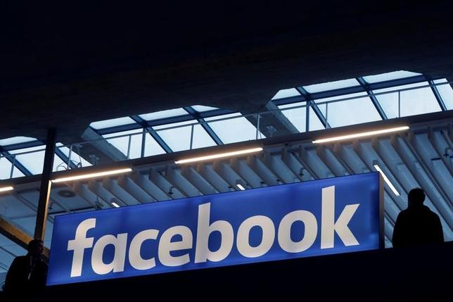 Facebook logo is seen  at a start-up companies gathering at Paris' Station F in Paris, France, January 17, 2017. REUTERS/Philippe Wojazer