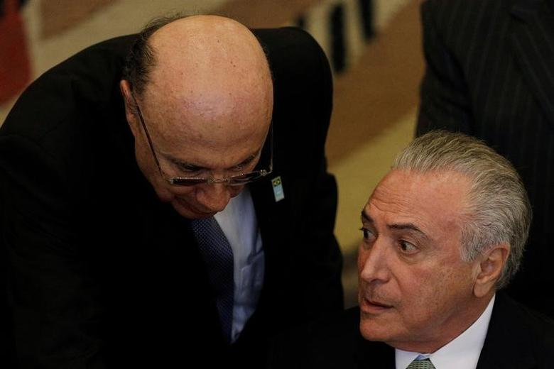 FILE PHOTO: Brazil's president Michel Temer speaks with Brazil's Finance Minister Henrique Meirelles during a meeting with Spanish Prime Minister Mariano Rajoy at the Itamaraty Palace in Brasilia, Brazil April 24, 2017. REUTERS/Ueslei Marcelino