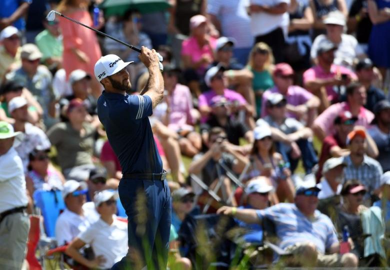 May 13, 2017; Ponte Vedra Beach, FL, USA;   Dustin Johnson follows his shot off the 17th tee box during the third round of The Players Championship golf tournament at TPC Sawgrass - Stadium Course. Mandatory Credit: Michael Madrid-USA TODAY Sports