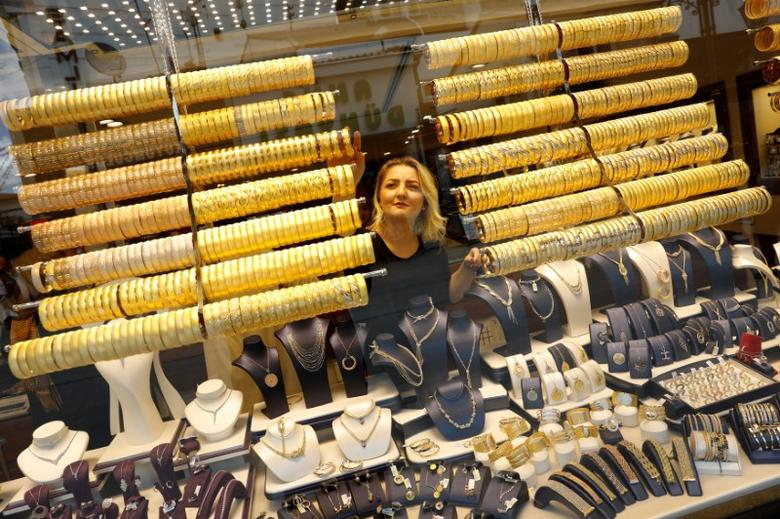 A woman checks products in a gold and jewellery store in the central Anatolian city of Corum, Turkey, May 11, 2017. Picture taken May 11, 2017. REUTERS/Umit Bektas