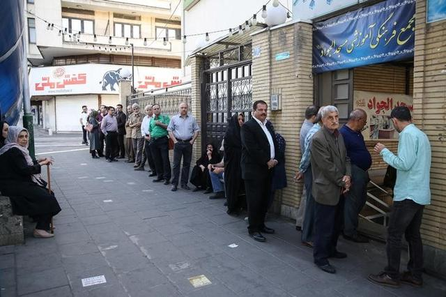 Iranian people wait for the polling station to open to vote during the presidential election in Tehran, Iran, May 19, 2017. TIMA via REUTERS