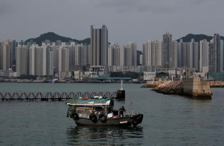 FIUEL PHOTO: A boat sails in front of private and public housing blocks in Hong Kong, China April 28, 2017.      REUTERS/Bobby Yip