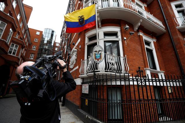 A cameraman films  outside the Ecuadorian embassy in London where WikiLeaks founder Julian Assange is taking refuge, London, Britain, May 19, 2017. REUTERS/Peter Nicholls