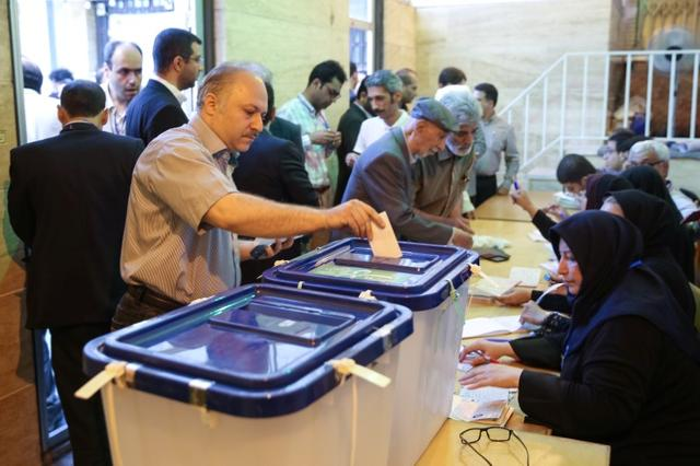 An Iranian man casts his vote into a ballot box during the presidential election in Tehran, Iran, May 19, 2017. TIMA via REUTERS ATTENTION EDITORS - THIS IMAGE WAS PROVIDED BY A THIRD PARTY. FOR EDITORIAL USE ONLY.