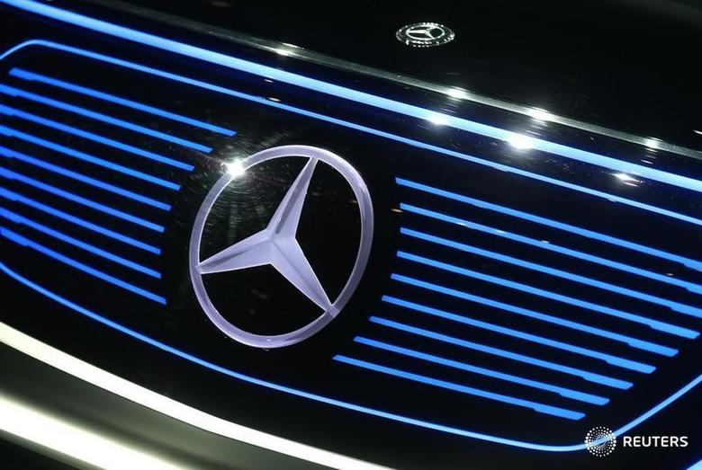 A Mercedes sign is seen on the car before the Daimler annual shareholder meeting in Berlin, Germany, March 29, 2017. REUTERS/Hannibal Hanschke  - RTX335UM
