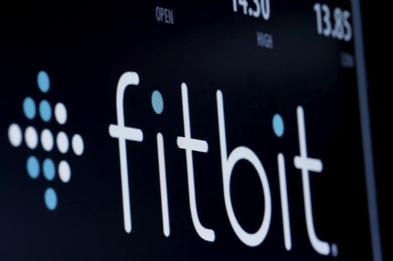 FILE PHOTO -  The ticker symbol for Fitbit is displayed at the post where it is traded on the floor of the New York Stock Exchange (NYSE) February 23, 2016. REUTERS/Brendan McDermid/File Photo