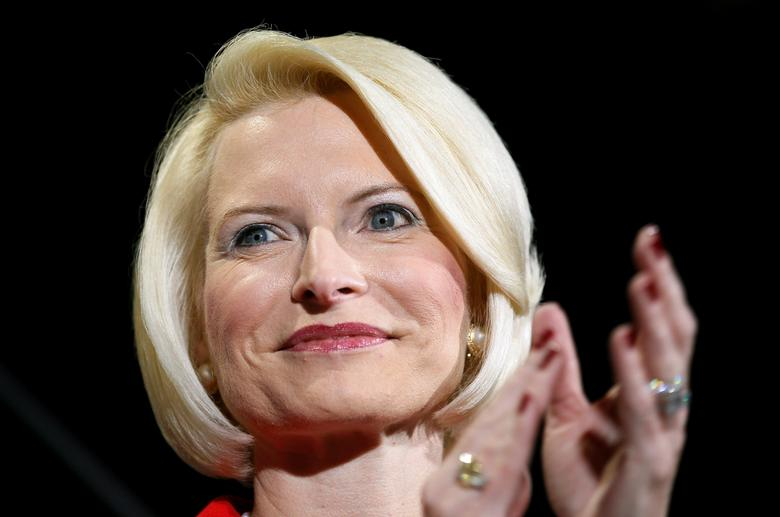 FILE PHOTO - Callista Gingrich applauds husband Republican presidential candidate Newt Gingrich at a campaign rally at Stoney's Rockin' Country dance hall in Las Vegas February 3, 2012. REUTERS/Rick Wilking/File Photo