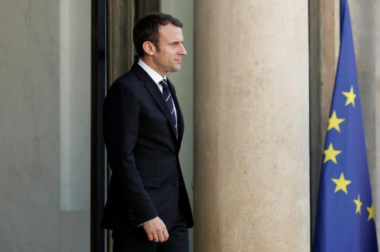 FILE PHOTO: French President Emmanuel Macron waits for a guest on the steps at the Elysee Palace in Paris, France, May 16, 2017.   REUTERS/Yoan Valat/Pool