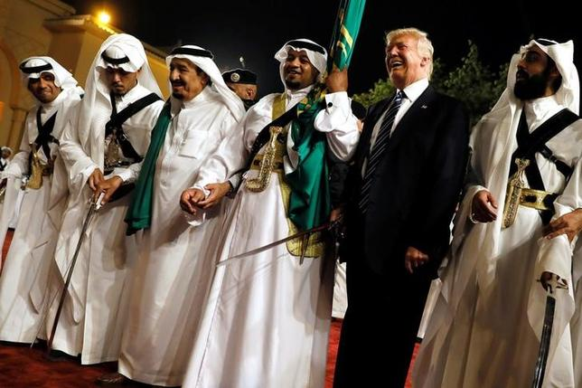 U.S. President Donald Trump dances with a sword as he arrives to a welcome ceremony by Saudi Arabia's King Salman bin Abdulaziz Al Saud at Al Murabba Palace in Riyadh, Saudi Arabia May 20, 2017. REUTERS/Jonathan Ernst