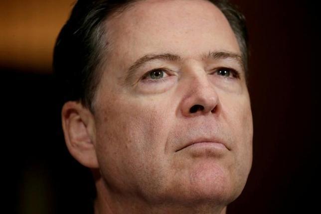 5月19日、米上院情報委員会は、トランプ大統領に解任されたコミー前連邦捜査局(FBI)長官(写真)が、同委員会で証言すると発表した。ワシントンで3日撮影(2017年 ロイター/Kevin Lamarque)