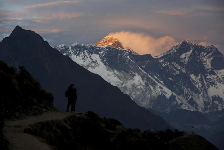FILE PHOTO: Light illuminates Mount Everest (C) during sunset in Solukhumbu district, also known as the Everest region, in this picture taken November 30, 2015. REUTERS/Navesh Chitrakar/File Photo
