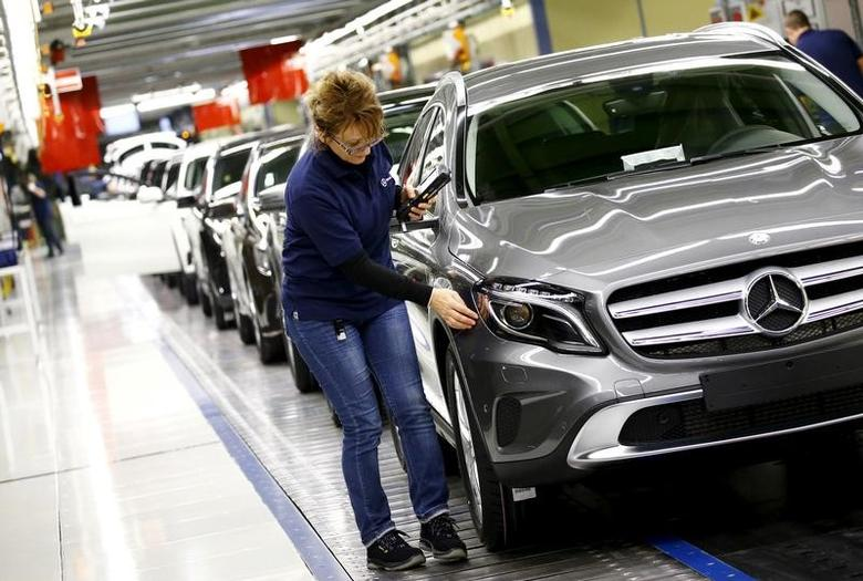 FILE PHOTO: Employees of German car manufacturer Mercedes Benz make final adjustments at the end of the Mercedes A class (A-Klasse) production line at the factory in Rastatt, Germany, January 22, 2016.    REUTERS/Kai Pfaffenbach/File Photo
