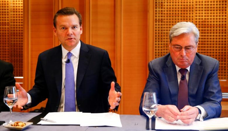 CEO Hariolf Kottmann (R) of Swiss chemical company Clariant sits beside Huntsman President and CEO Peter Huntsman as he addresses a news conference in Zurich, Switzerland May 22, 2017. REUTERS/Arnd Wiegmann
